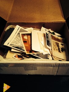 trying to create order from a jumbled box of family photos